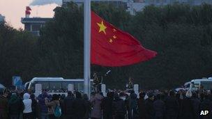 People raise Chinese flag in Beijing, China November 2012