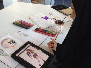 Pupil using iPad for art lesson