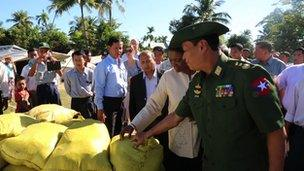 Valerie Amos is shown food supplies at the Rakhine camp on Myebon
