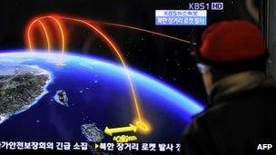 A man in Seoul watches South Korea's TV report on North Korea's rocket launch. Photo: 12 December 2012