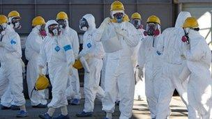 Tepco workers at the Fukushima nuclear power plant on 12 February 2012