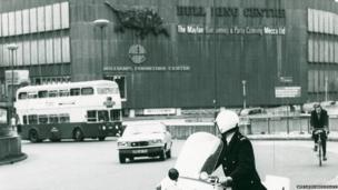 A police officer on a motorcycle outside Birmingham's Bull Ring shopping centre in the early 1970s.