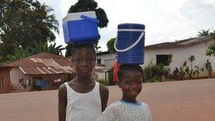 Children selling low-value goods at the roadside are a familiar sight in Liberia