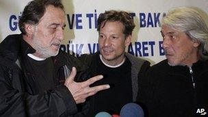 NBC chief foreign correspondent Richard Engel, center, NBC Turkey reporter Aziz Akyavas, left, and NBC photographer John Kooistra, right, speak during a news conference in Reyhanli, Turkey 18 December 2012