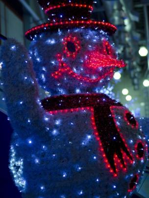 Snowman covered in festive lights