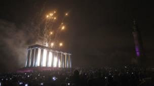 A finale of fireworks after a torchlight procession through Edinburgh as part of the pre Hogmanay celebrations.