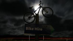 Bike illuminated by moonlight