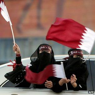 Qatari women celebrate their country's successful bid to host the 2022 World Cup