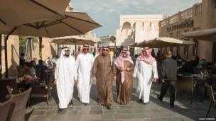 Saudi Arabian visitors stroll through Souk Waqif, home to many traditional Arabic restaurants and a focal point for visitors, local families and tourists.