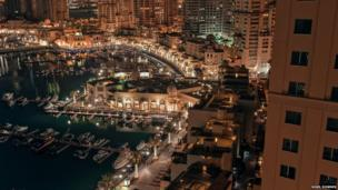Porto Arabia, part of a huge construction project, is a man-made island off the coast of Qatar. Its waterfront cafes and restaurants are fast becoming a place where the local and expat communities meet, says Nigel Downes.