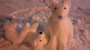 Two polar bears made of snow.