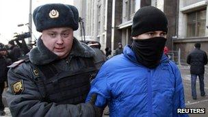 A Russian policeman detains a man who attacked gay rights campaigners outside the State Duma in Moscow, 25 January
