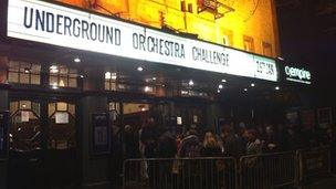 People queuing to go into the Underground orchestra concert
