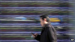 Man using mobile on the move