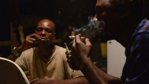 Fishermen smoking and chewing khat in a shack in Mombasa's old port