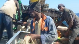 Crew members aboard the Kenyan fishing vessel prepare the longline