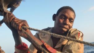 Bubu, aboard a Kenyan fishing vessel, hoisting the sail