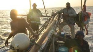 Crew members aboard the Kenyan fishing vessel sailing back to Mombasa port