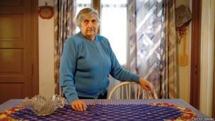 Clara Atelman de Fink standing in her home.
