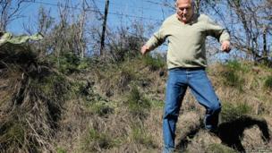 Mario Alfredo Amestoy running through grass.