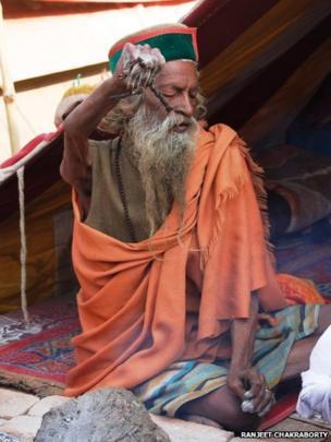 A holy man with arm held aloft. Photo: Ranjeet Chakraborty