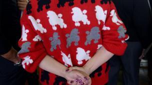 Lady wears poodle jumper