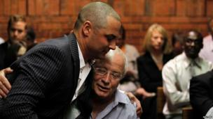 Carl and Henke Pistorius in court in Pretoria, 21 February 2013