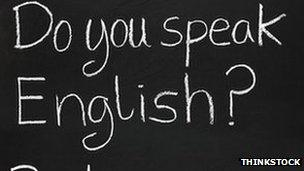English and French writing on a blackboard