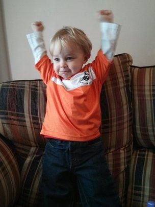 Young fan Rex who is almost two cheering the Swans on from home in Swansea. Photo sent in by Martyn and Cassy
