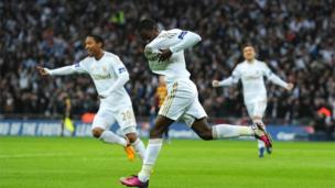 "Swansea City""s Nathan Dyer (centre) celebrates scoring their first goal of the game during the Capital One Cup Final match at Wembley"