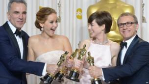 Daniel Day-Lewis, Jennifer Lawrence, Anne Hathaway and Christoph Waltz pose with their Oscars.