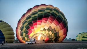 A balloon inflates at the launch area before the morning flight on 26 February 2013