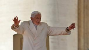 Pope Benedict XVI waves from the altar during his last weekly audience, 27 February 2013