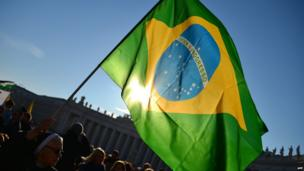 A Brazilian flag among the crowd at St Peter's Square, 27 February 2013