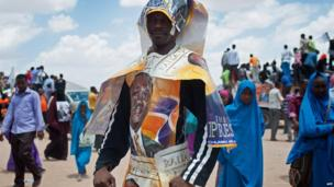 A man wears political posters during an ODM/CORD coalition rally in Garissa, Kenya, on 27 February 2013