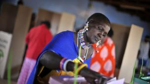 A Masaai woman casts her vote in the general election in Ilbissil, Kenya. 4 March 2013