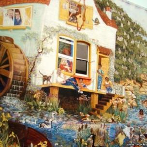 Huge mural covering the entire side of a house, of a watermill and mill pond with people swimming in it. Picture: Steve Thomas