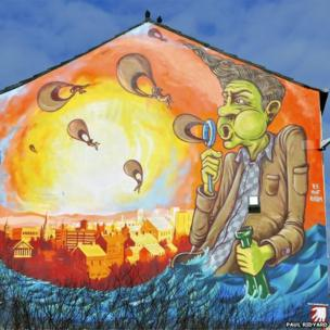 Mural of a bubble blowing character watching the sun set over the Preston cityscape. Picture: Paul Ridyard