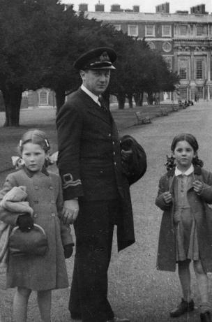 """Lieutenant Theo """"Rusty"""" Ionides with his daughters Penelope and Anthea at Hampton Court Palace"""
