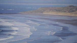 Roger Phillips of Lampeter sent in this photo of waves on Rhossili beach, Gower
