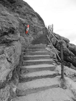 "Denize McIntyre sent this picture which was taken on a fine but freezing day on Castle Beach, Tenby. ""It looks a lot of steps to climb,"" she said."