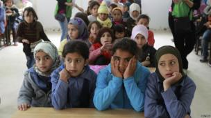 Children at a makeshift school in Zaatari refugee camp
