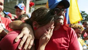 Chavez supporters react as his coffin passes in a procession - 6 March