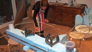 Rebecca Newnham at work on the sculpture