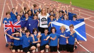 Hurdler Sally Pearson celebrates with school children in Sydney, Australia