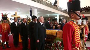 Cuba's Raul Castro, Bolivia's Evo Morales, Nicaragua's Daniel Ortega and Ecuador's Rafael Correa on the right-hand side of the coffin