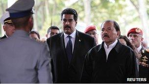 Nicolas Maduro and Daniel Ortega at the military academy in Caracas. 9 March 2012