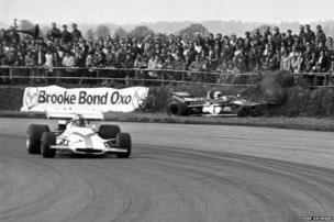 Jackie Stewart's Tyrrell 003 hits the earth bank on the outside of Copse Corner, Silverstone