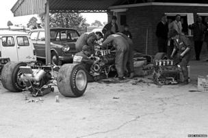 Mechanics work on Graham Hill's Lotus 49B