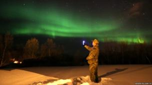 Royal Marine Captain Chris McGinley takes a picture of the Northern Lights